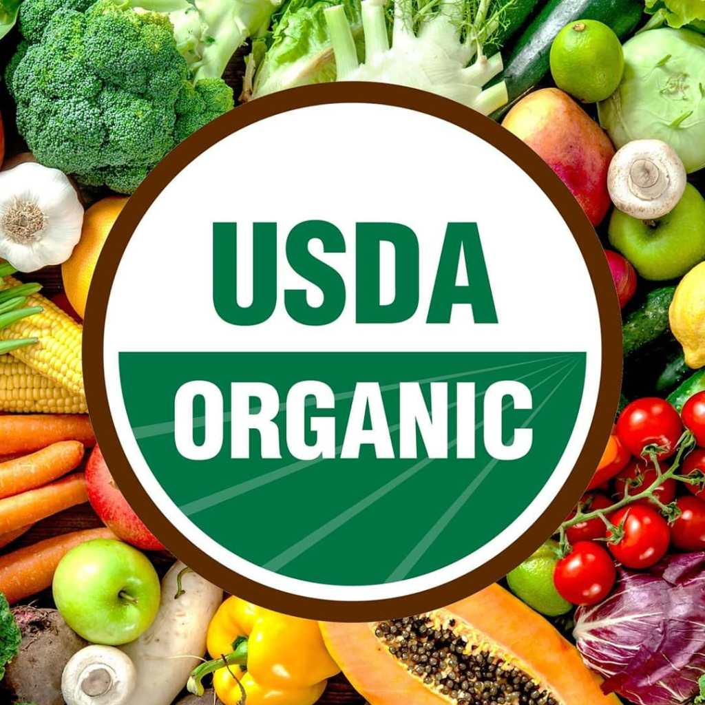 USDA Organic emblem over a variety of fruits and vegetables