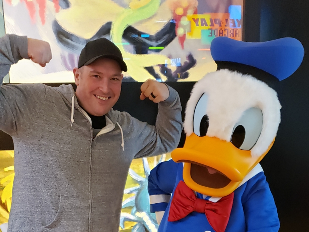 Andy Phillips (with Donald Duck), the Everyday Akron host for the week of Nov. 22, 2020