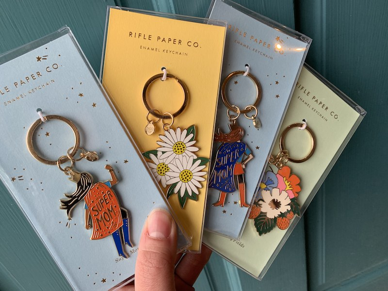 """floral and """"Super Mom"""" enamel keychains by Rifle Paper Co."""